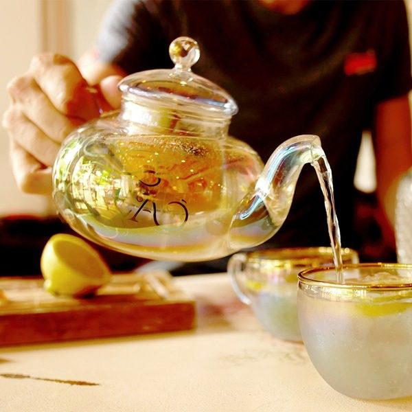 Glass-Teapot-and-Teacup-with-Gold-Details