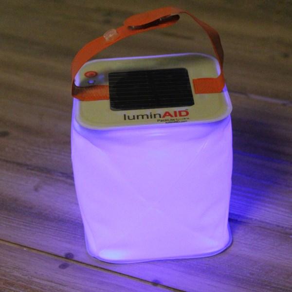 Multi coloured portable travel lantern by LuminAid