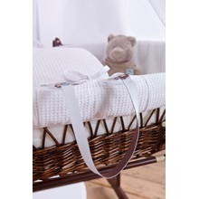 Baby-Wicker-Moses-Basket-With-White-Waffle-Quilt.jpg