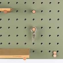Green-Bundy-Peg-Board-with-Shelves-and-Hooks.jpg
