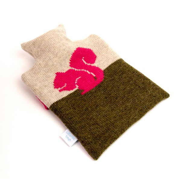 Knitted wool hot water bottle cover in pink squirrel