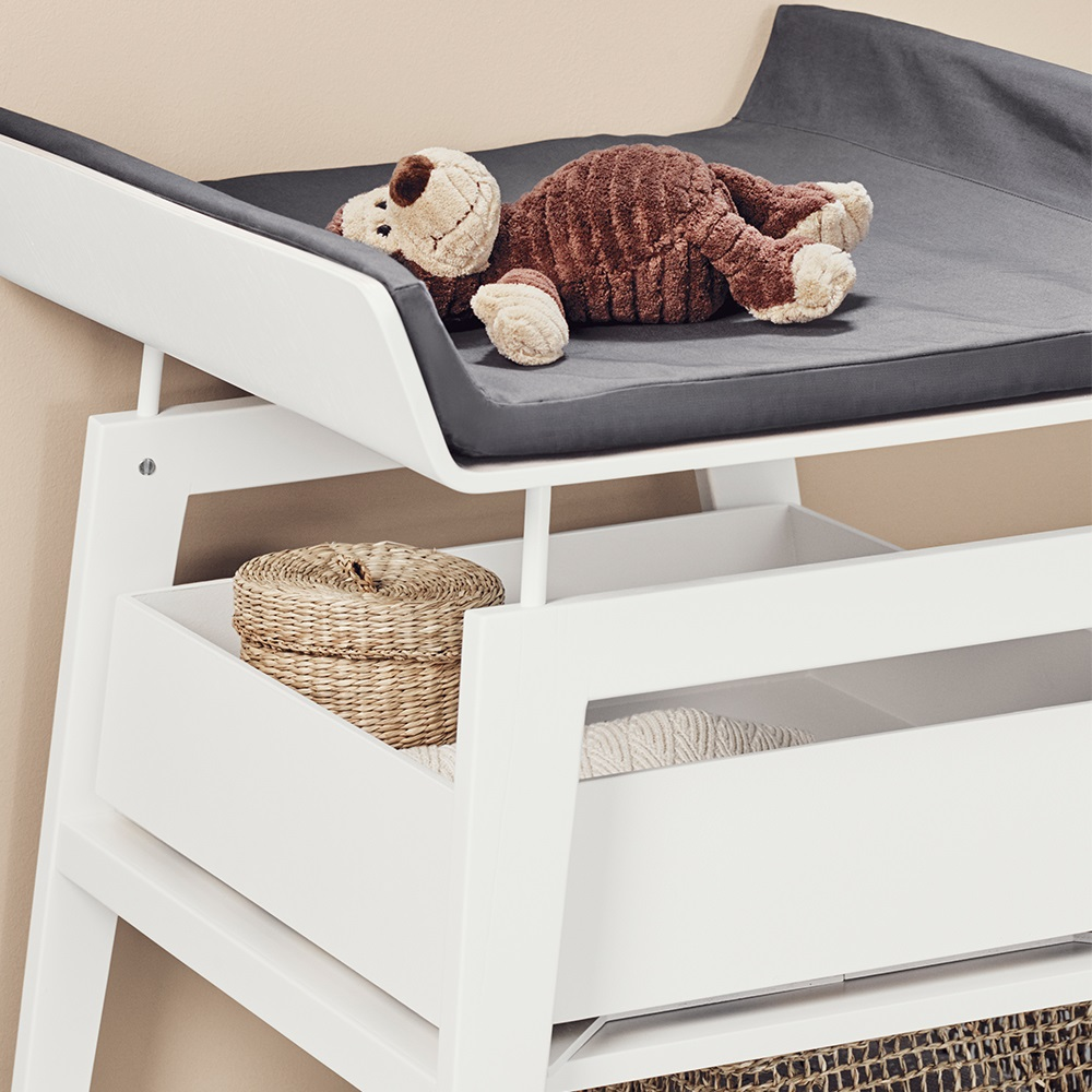 linea changing table with foam mat in white nursery. Black Bedroom Furniture Sets. Home Design Ideas
