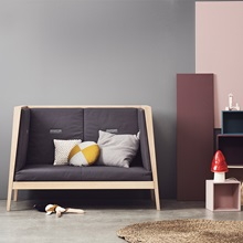 Linea-Cot-Sofa-with-Warm-Purple-Fabric-Bumpers-in-Oak.jpg