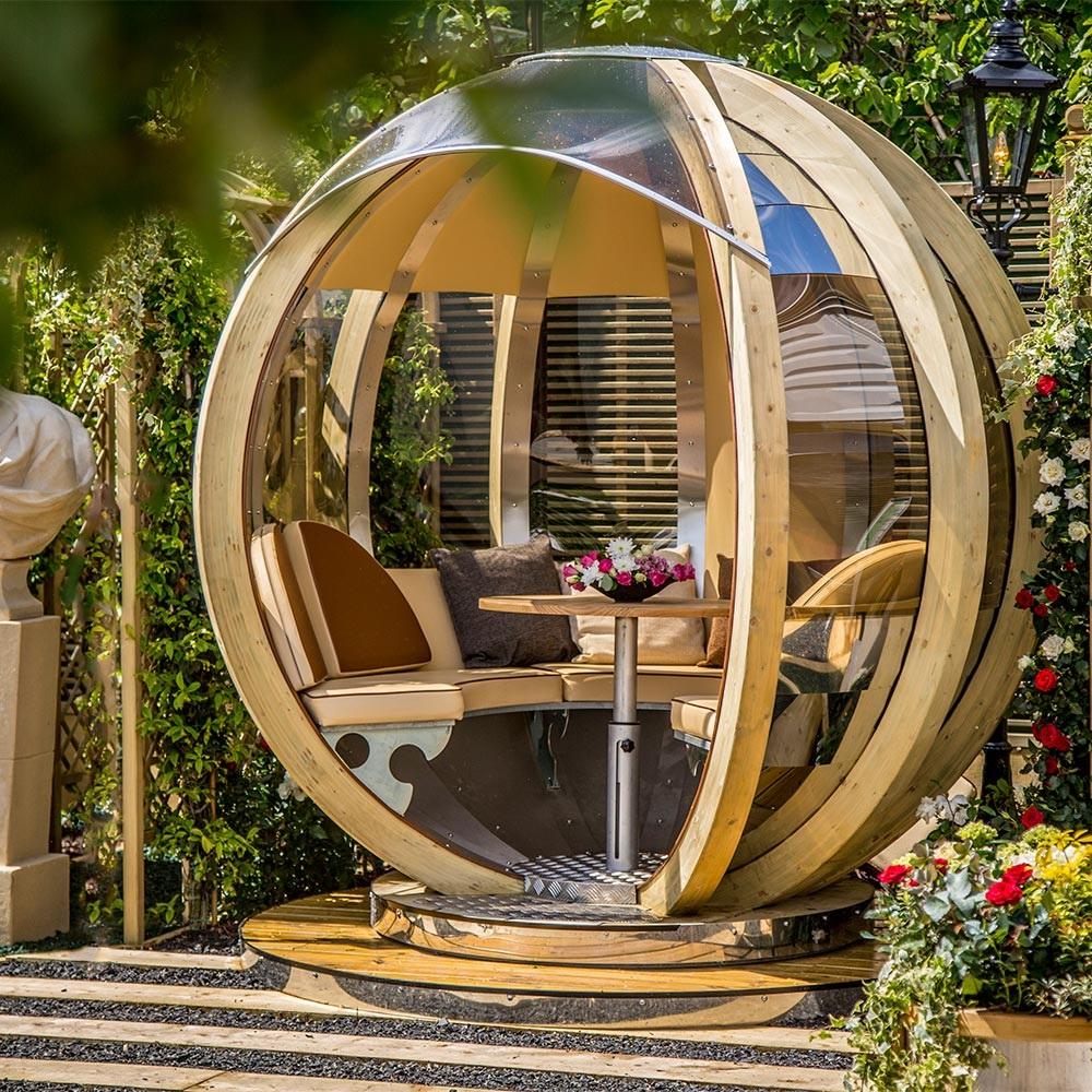 Luxury rotating lounger garden pod garden buildings for Unusual garden rooms