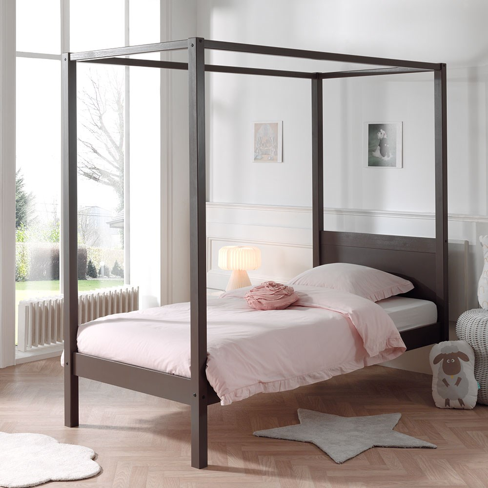 brown single bed frame with canopy