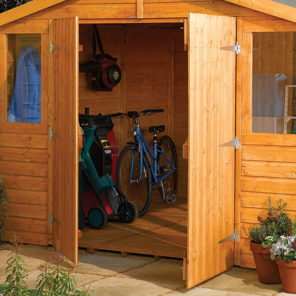 Wooden outdoor workshop in honey brown log cabins for Garden shed gin
